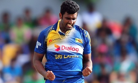 Sri Lankan bowler Thisara Perera celebrates after dismissing Pakistan batsman Ahmed Shehzad during the first One Day International (ODI) match between Sri Lanka and Pakistan at the Suriyawewa Mahinda Rajapakse International Cricket Stadium in the southern district of Hambantota on  August 23, 2014.  AFP PHOTO/ LAKRUWAN WANNIARACHCHI        (Photo credit should read LAKRUWAN WANNIARACHCHI/AFP/Getty Images)