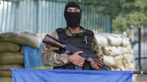 "A soldier of Ukrainian self-defence battalion ""Azov"" stands guard at their base in Mariupol"